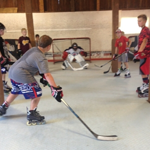 group of players in the barn at farm tough hockey